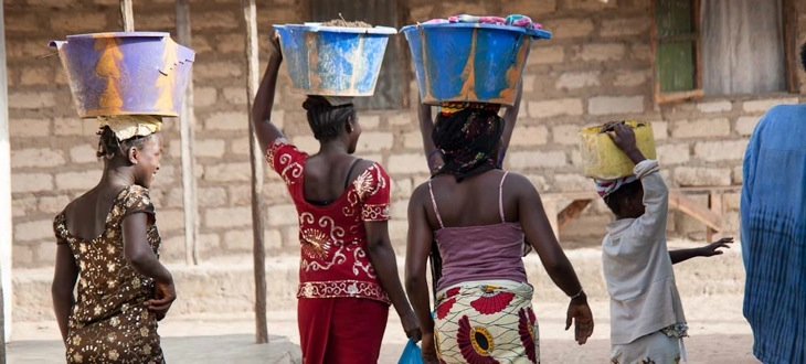 women-carrying-water